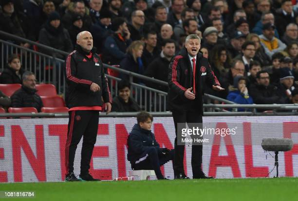 Ole Gunnar Solskjaer Interim Manager of Manchester United and Mike Phelan coach of Manchester United give instructions during the Premier League...
