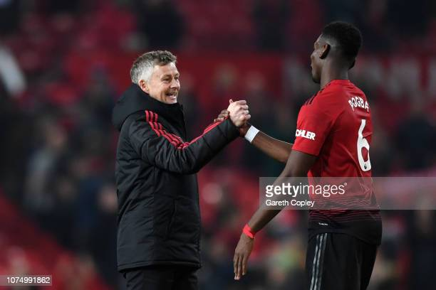 Ole Gunnar Solskjaer, Interim Manager of Manchester United and Paul Pogba of Manchester United celebrate following their sides victory in the Premier...