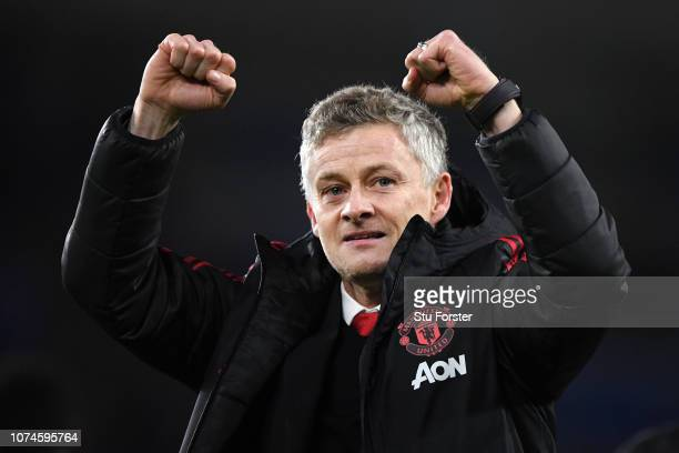 Ole Gunnar Solskjaer Interim Manager of Manchester United celebrates following his sides victory in the Premier League match between Cardiff City and...