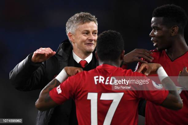 Ole Gunnar Solskjaer Interim Manager of Manchester United celebrates with Fred and Paul Pogba of Manchester United following the final whistle of the...