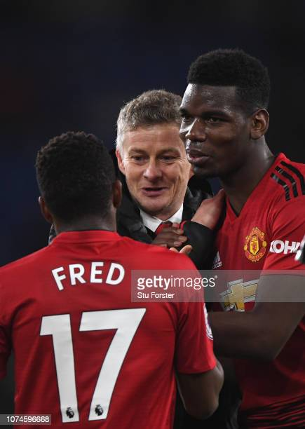 Ole Gunnar Solskjaer, Interim Manager of Manchester United celebrates with Fred and Paul Pogba after the Premier League match between Cardiff City...