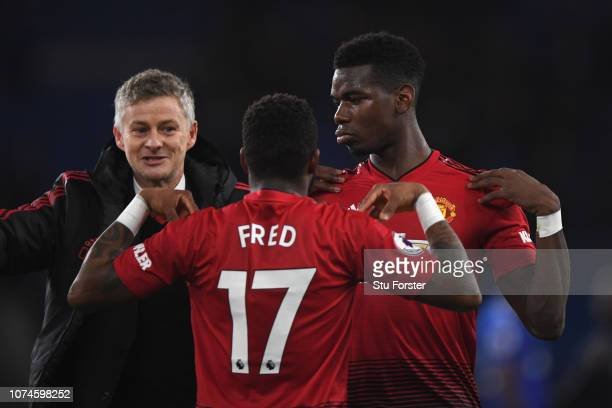 Ole Gunnar Solskjaer Interim Manager of Manchester United celebrates with Fred and Paul Pogba after the Premier League match between Cardiff City and...