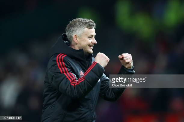 Ole Gunnar Solskjaer Interim Manager of Manchester United celebrates following his sides victory in the Premier League match between Manchester...