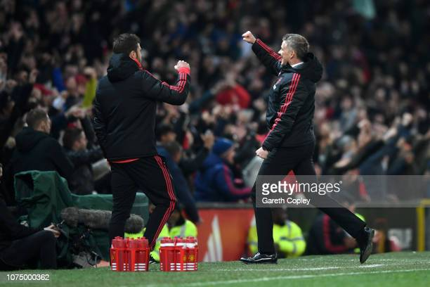 Ole Gunnar Solskjaer Interim Manager of Manchester United celebrates with his backroom staff after Paul Pogba of Manchester United scored their...