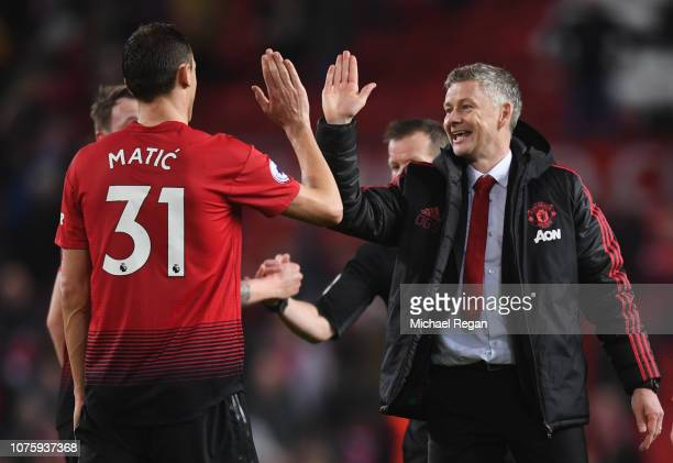 Ole Gunnar Solskjaer Interim Manager of Manchester United celebrates victory with Nemanja Matic after the Premier League match between Manchester...