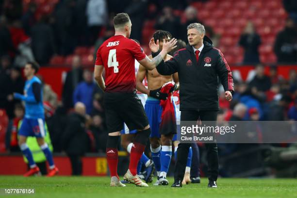 Ole Gunnar Solskjaer Interim Manager of Manchester United celebrates with Phil Jones of Manchester United following their sides victory in the FA Cup...