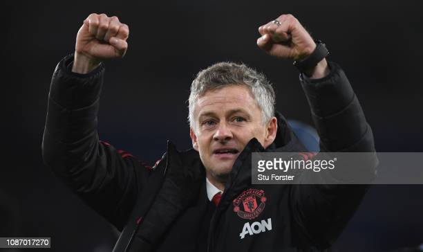 Ole Gunnar Solskjaer Interim Manager of Manchester United celebrates with the fans after the Premier League match between Cardiff City and Manchester...
