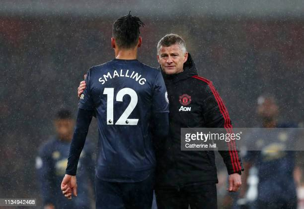Ole Gunnar Solskjaer Interim Manager of Manchester United consoles Chris Smalling of Manchester United following the Premier League match between...