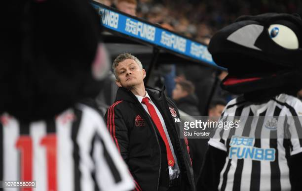 Ole Gunnar Solskjaer Interim Manager of Manchester United looks on in between a couple of magpies during the Premier League match between Newcastle...