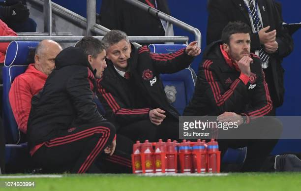 Ole Gunnar Solskjaer Interim Manager of Manchester United looks on from the bench with Michael Carrick during the Premier League match between...