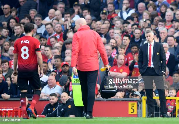 Ole Gunnar Solskjaer Interim Manager of Manchester United reacts as Juan Mata of Manchester United leaves the pitch due to injury during the Premier...