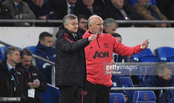 Ole Gunnar Solskjaer Interim Manager of Manchester United reacts with Mike Phelan during the Premier League match between Cardiff City and Manchester...
