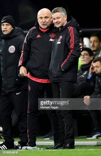 Ole Gunnar Solskjaer Interim Manager of Manchester United speaks to Mike Phelan Manchester United assistant manager during the Premier League match...