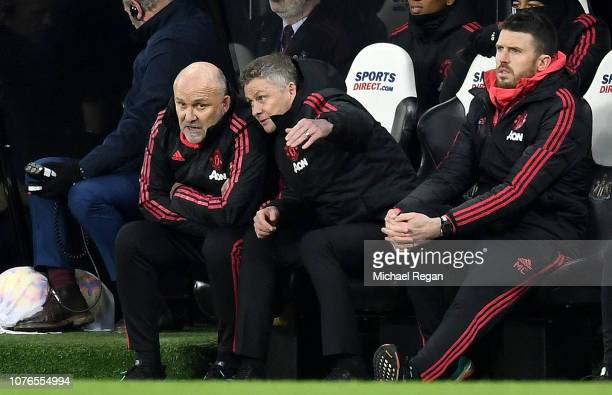 Ole Gunnar Solskjaer Interim Manager of Manchester United speaks to Mike Phelan Manchester United assistant manager as Michael Carrick Manchester...