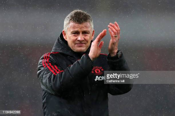 Ole Gunnar Solskjaer Interim Manager of Manchester United acknowledges the fans following the Premier League match between Arsenal FC and Manchester...