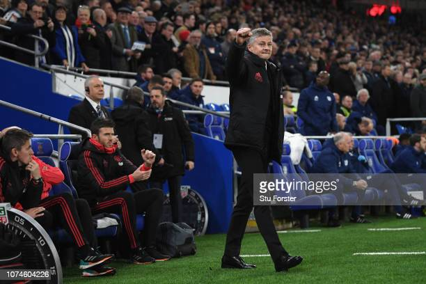 Ole Gunnar Solskjaer Interim Manager of Manchester United acknowledges the United fans before the Premier League match between Cardiff City and...