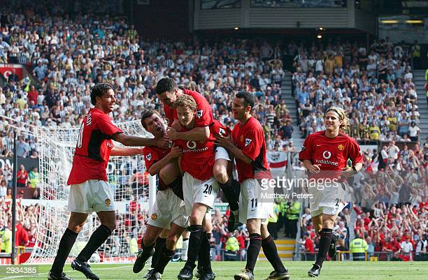 Ole Gunnar Solskjaer is congratulated by Ruud van Nistelrooy Roy Keane John O'Shea Ryan Giggs and Diego Forlan after scoring Man Utd's first...