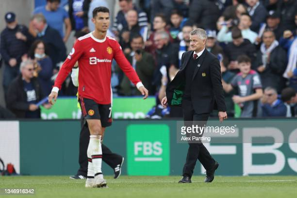 Ole Gunnar Solskjaer, Manager of Manchester United and Cristiano Ronaldo of Manchester United react following their side's defeat in the Premier...