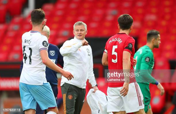Ole Gunnar Solskjaer Manager of Manchester United and Declan Rice of West Ham United speak following the Premier League match between Manchester...