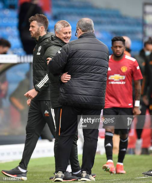 Ole Gunnar Solskjaer, Manager of Manchester United and Marcelo Bielsa, Manager of Leeds United interact following the Premier League match between...