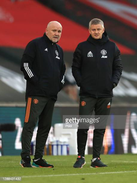 Ole Gunnar Solskjaer, Manager of Manchester United and Mike Phelan, Assistant Manager of Manchester United look on during the Premier League match...