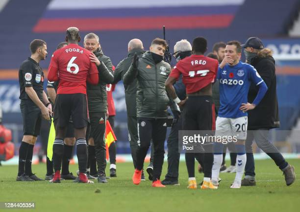 Ole Gunnar Solskjaer, Manager of Manchester United and Paul Pogba of Manchester United celebrate following their team's victory in the Premier League...