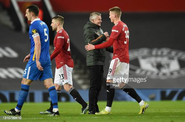 Ole Gunnar Solskjaer, Manager of Manchester United and Scott McTominay of Manchester United interact following their sides victory in the Premier...