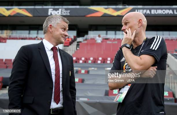 Ole Gunnar Solskjaer Manager of Manchester United and Stale Solbakken Manager of FC Kobenhavn talk prior to the UEFA Europa League Quarter Final...