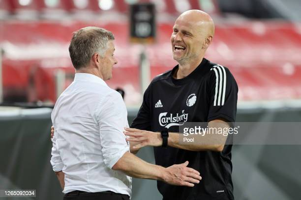 Ole Gunnar Solskjaer, Manager of Manchester United and Stale Solbakken, Manager of FC Kobenhavn talk following the UEFA Europa League Quarter Final...