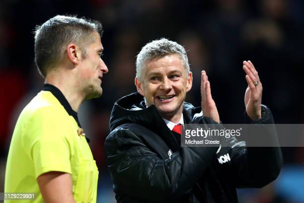 Ole Gunnar Solskjaer Manager of Manchester United applauds fans during the UEFA Champions League Round of 16 First Leg match between Manchester...
