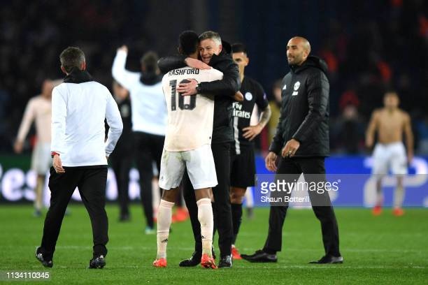 Ole Gunnar Solskjaer Manager of Manchester United celebrates victory with Marcus Rashford during the UEFA Champions League Round of 16 Second Leg...