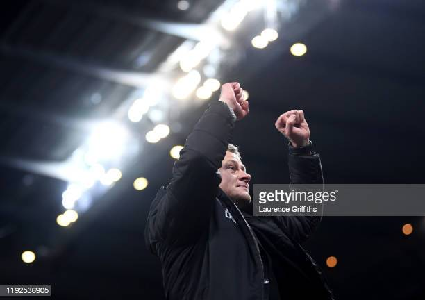 Ole Gunnar Solskjaer Manager of Manchester United celebrates victory at the end of the match during the Premier League match between Manchester City...
