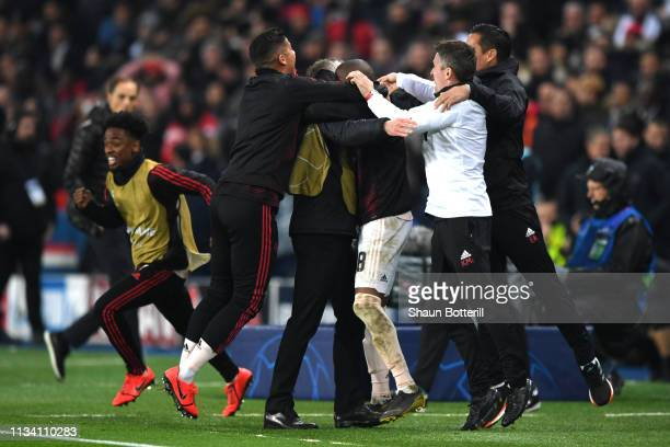Ole Gunnar Solskjaer Manager of Manchester United celebrates with backroom staff after his side score their third goal during the UEFA Champions...