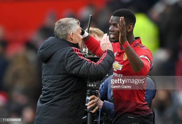 Ole Gunnar Solskjaer, Manager of Manchester United celebrates with Paul Pogba of Manchester United at full-time of the Premier League match between...
