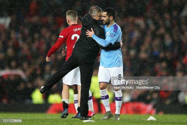 Ole Gunnar Solskjaer Manager of Manchester United consoles Ilkay Gundogan of Manchester City at full time during the Premier League match between...