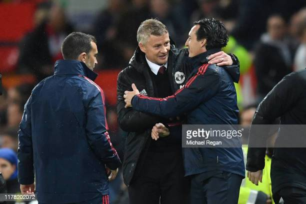Ole Gunnar Solskjaer, Manager of Manchester United embraces Unai Emery, Manager of Arsenal after the Premier League match between Manchester United...