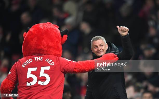 Ole Gunnar Solskjaer Manager of Manchester United enjoys a moment with Fred the Red the Manchester United Mascot prior during the Premier League...