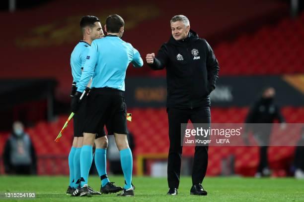 Ole Gunnar Solskjaer, Manager of Manchester United fist bumps with match officials following the UEFA Europa League Semi-final First Leg match...