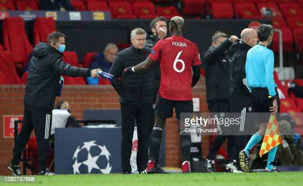 Ole Gunnar Solskjaer Manager of Manchester United gives instructions to Paul Pogba during the UEFA Champions League Group H stage match between...