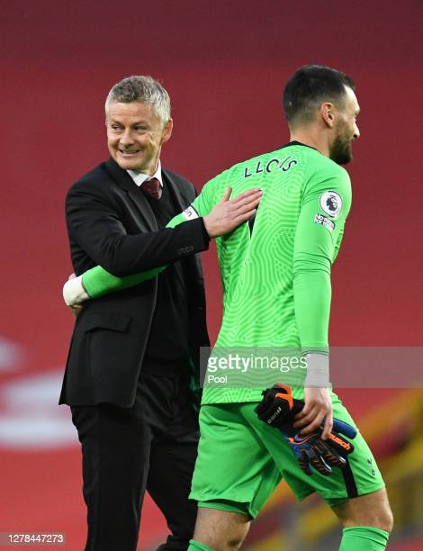 Ole Gunnar Solskjaer Manager of Manchester United interacts with Hugo Lloris of Tottenham Hotspur following the Premier League match between...
