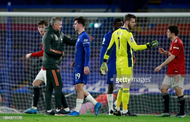 Ole Gunnar Solskjaer, Manager of Manchester United interacts with Mason Mount of Chelsea as David De Gea of Manchester United interacts with team...