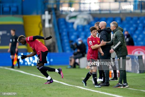 Ole Gunnar Solskjaer, Manager of Manchester United interacts with Daniel James of Manchester United after he is replaced by team mate Paul Pogba...