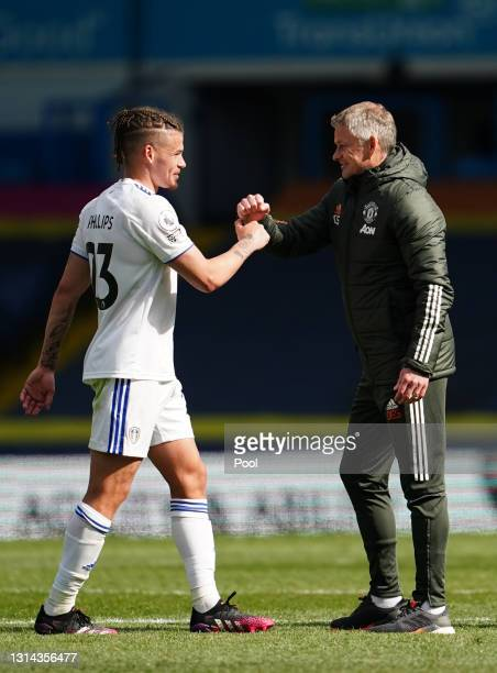 Ole Gunnar Solskjaer, Manager of Manchester United interacts with Kalvin Phillips of Leeds United following the Premier League match between Leeds...