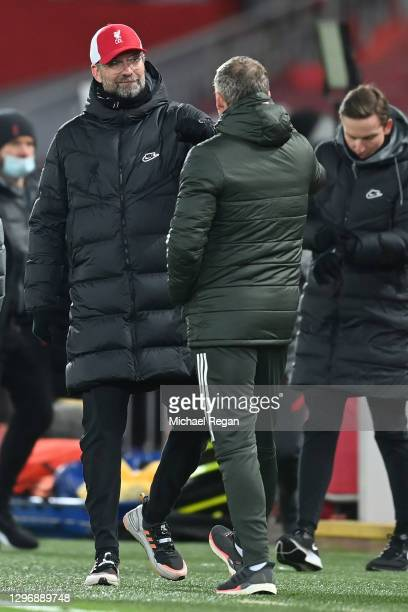 Ole Gunnar Solskjaer, Manager of Manchester United interacts with Jurgen Klopp, Manager of Liverpool following the Premier League match between...