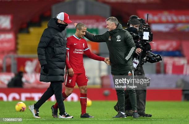 Ole Gunnar Solskjaer, Manager of Manchester United interacts with Jurgen Klopp, Manager of Liverpool and Thiago Alcantara after the Premier League...