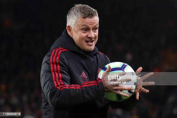Ole Gunnar Solskjaer Manager of Manchester United is seen with a match ball prior to the Premier League match between Wolverhampton Wanderers and...