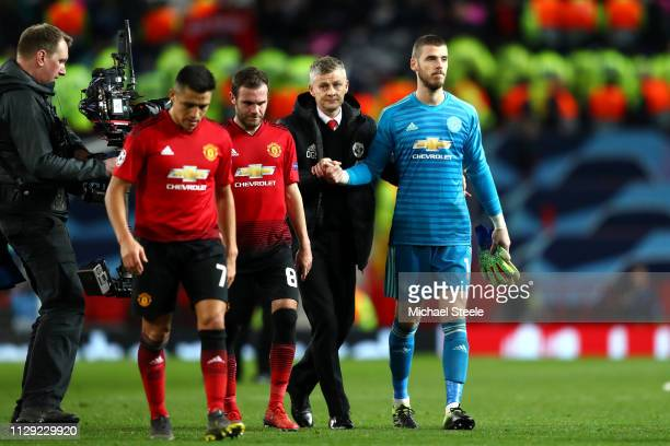 Ole Gunnar Solskjaer Manager of Manchester United leaves the pitch with David De Gea and team mates during the UEFA Champions League Round of 16...