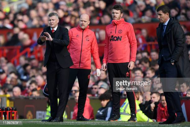 Ole Gunnar Solskjaer, Manager of Manchester United looks on with coaches Mike Phelan and Michael Carrick during the Premier League match between...
