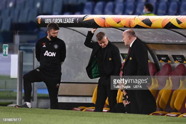 Ole Gunnar Solskjaer, Manager of Manchester United looks on with Assistant Coaches, Michael Carrick , Mike Phelan during the UEFA Europa League...