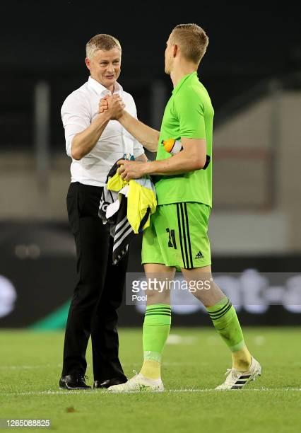 Ole Gunnar Solskjaer, Manager of Manchester United shakes hands with Karl-Johan Johnsson of FC Kobenhavn following the UEFA Europa League Quarter...